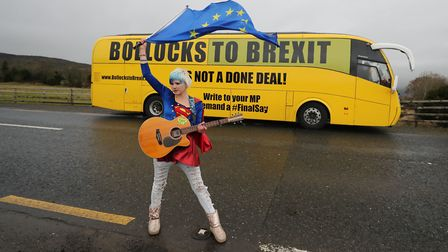 """EU Supergirl Madeleina Kay stands in front of the """"Bollocks to Brexit"""" campaign bus as it stops just"""