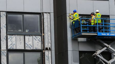 Cladding is removed from a building in the wake of the Grenfell Tower fire. Picture: Peter Byrne/PA
