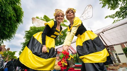 Two bumble bees on stilts attract attention to the North London Beekeepers stall. Picture: Siorna As