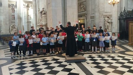 Hackney Childrens Choir singing with the Choristers St Pauls Cathedral under their director Andrew
