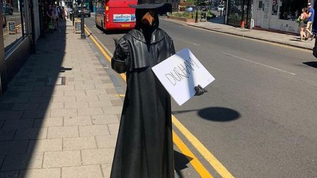 Crouch End's 'plague doctor' mocks government adviser Dominic Cummings. Picture: Judah Moss