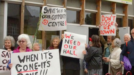 Protesters wave placards outside the Highgate Newtown Community Centre. Picture: Tim Megarry