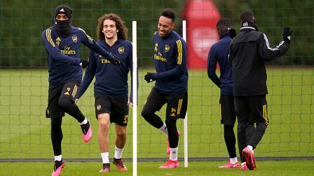 Arsenal's Alexandre Lacazette (left) Matteo Guendouzi and Pierre-Emerick Aubameyang during the train