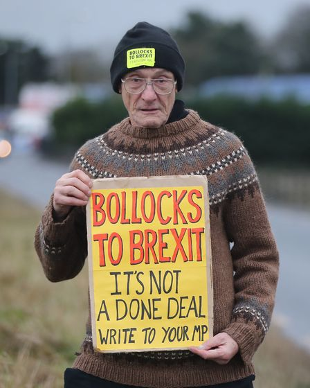 """Campigner Martin Housden outside the Carrickdale Hotel as the """"Bollocks to Brexit"""" bus tour stops ju"""