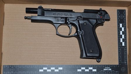 Police officers seized a Bruni model 92 pistol from an address. Picture: Organised Crime Partnership