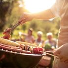 Save money on a BBQ and cooking utensils and enjoy eating outside this summer. Picture: Getty Images