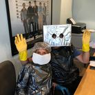 Beatrix and Mike Clark dressed in homemade Covid 19 PPE for a Zoom quiz. Picture: Oli Clark