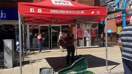 Nigel Ashcroft performs at the street market. Photo: Leanna Coleman.