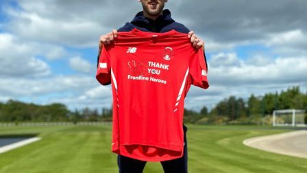 Harry Kane reveals Leyton Orient's new home shirt for next season (pic Leyton Orient)