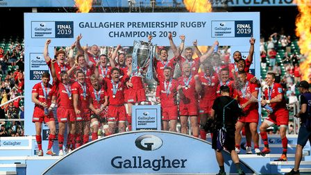 Saracens players lift the trophy following victory in the Gallagher Premiership Final at Twickenham