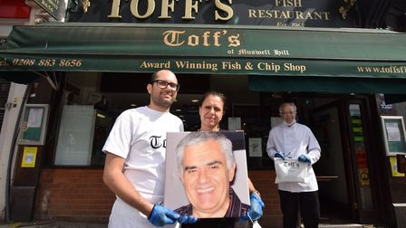 At the fish and chip shop's reopening, George Georgiou's son Christopher (left), his wife Giga (cent