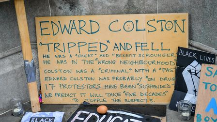 Signs and placards at the base of the Edward Colston statue plinth in Bristol city centre. Picture: