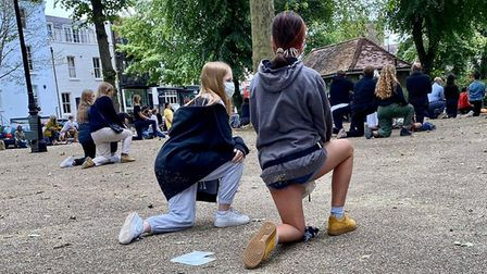 Teenagers Charlotte Collins and Darcy Parfitt kneel at Highate's Black Lives Matter protest. Picture