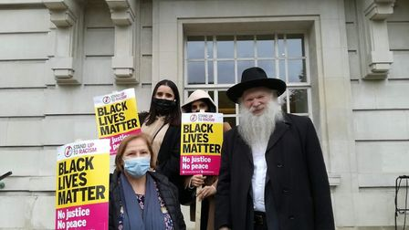 Rabbi Herschel Gluck with protesters at the Black Lives Matter protest outside Hackney Town Hall. Pi