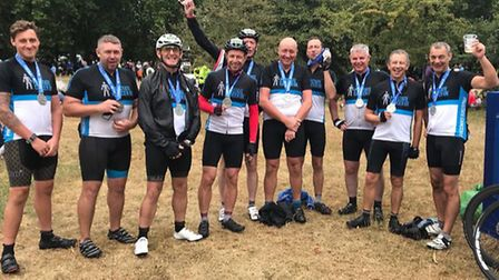 Southwold town crier David Burrows (second from left) conquered a charity cycle alongside family and