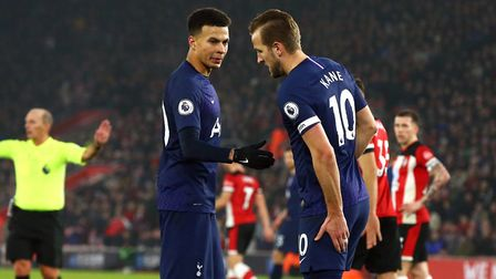 Tottenham Hotspur's Harry Kane indicates to his bench that he has hurt his hamstring