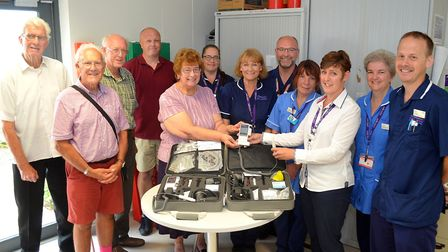 Pat Rayner, Chairman of Friends Supporting Lowestoft Healthcare, presents new Toe Dopplers to East C