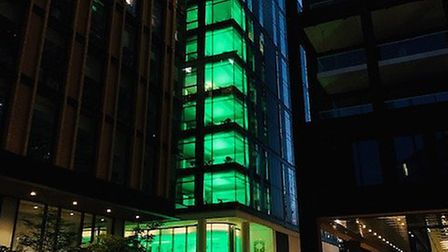 Camden Council's builiding in 5 Pancras Square lit green to mark the Grenfell Tower fire three years