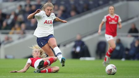 Tottenham's Rianna Dean is tackled by Arsenal's Leah Williamson during their WSL derby (pic PA)