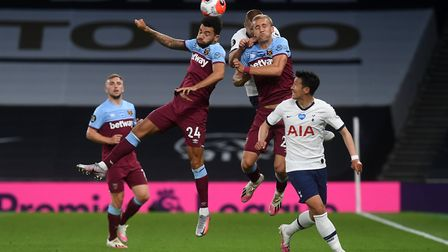 West Ham United's Ryan Fredericks heads the ball during the Premier League match at the Tottenham Ho