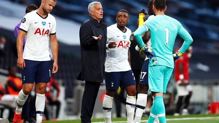 Tottenham Hotspur manager Jose Mourinho speaks to his players during a drinks break in the Premier L