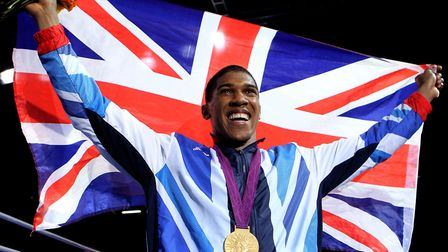 Great Britain's Anthony Joshua celebrates with his gold medal following his super heavyweight final