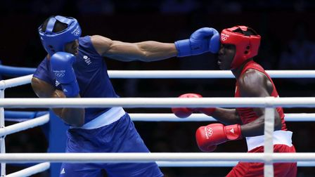 Great Britain's Anthony Joshua (left) takes on Cuba's Erislandy Savon Cotilla in the nen's super-hea