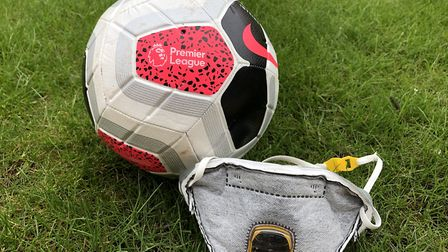 A Premier League football with a PPE face mask