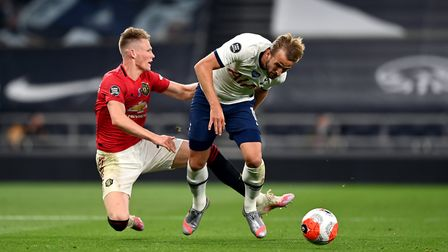 Tottenham Hotspur's Harry Kane (right) and Manchester United's Scott McTominay battle for the ball