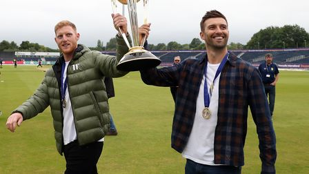 Ben Stokes (left) and Mark Wood celebrate with the ICC World Cup ahead of a Vitality Blast T20 match