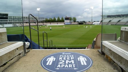 Social distancing signage is seen around the ground during day two of a warm-up match at the Ageas B