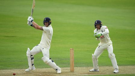 England's Ben Stokes hits a boundary as Jos Buttler looks on during day two of a warm-up match at th