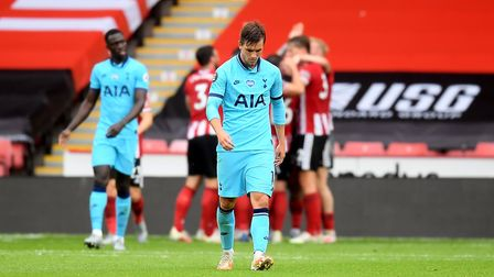 Tottenham Hotspur's Giovani Lo Celso appears dejected as Sheffield United's Lys Mousset celebrates s