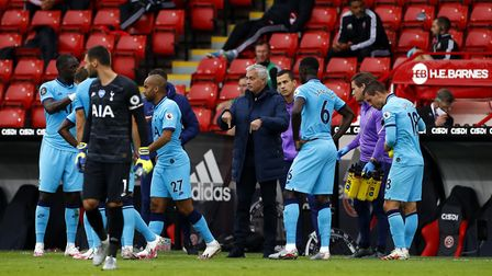 Tottenham Hotspur manager Jose Mourinho speaks to his players during a drinks break