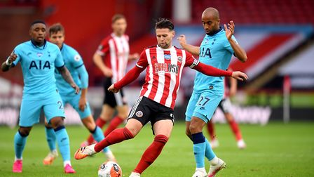 Sheffield United's Oliver Norwood and Tottenham Hotspur's Lucas Moura (right) battle for the ball