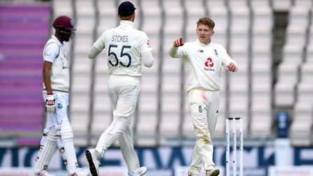 England's Dom Bess (right) celebrates taking the wicket of West Indies' Jermaine Blackwood during da