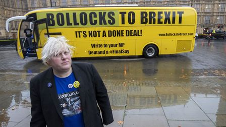 """Boris Johnson lookalike Drew Galdron, who styles himself as Faux Bojo, stands in front of the """"Bollo"""