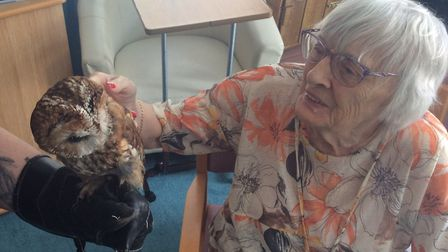 Resident Rita Bessey with Bobby the owl. Picture: Greensleeves Care