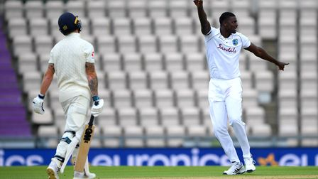 West Indies' captain Jason Holder (right) celebrates taking the wicket of England captain Ben Stokes