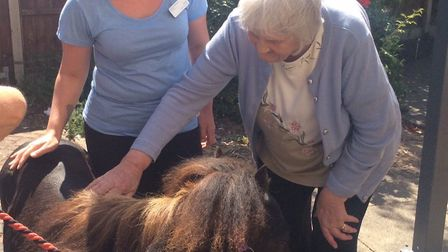 Resident Ruth Lovell and staff member Emma Baldry with Bow Bow the pony. Picture: Greensleeves Care