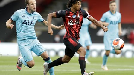 Tottenham Hotspur's Harry Kane (left) and Bournemouth's Nathan Ake battle for the ball
