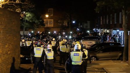 Police attempt to disperse a street party in Riverton Close, W9. Picture: David Nathan