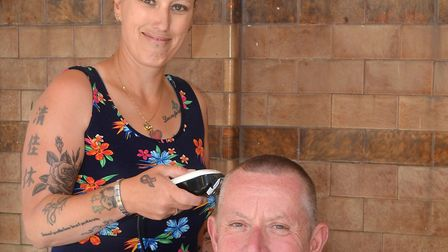 Phil Davis and his wife, Julie-Ann Davis, who operated the clippers at his Brave the Shave event. Pi