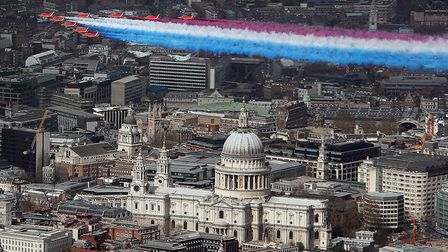 The Royal Air Force (RAF) Red Arrows fly in formation with four Typhoon aircraft over central London