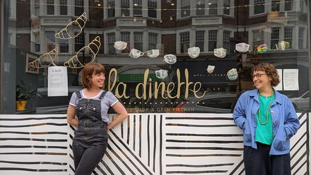 Masks made by Muswell Hill artist Emma Franks are on display in the window of Claire Jury's La Dinet