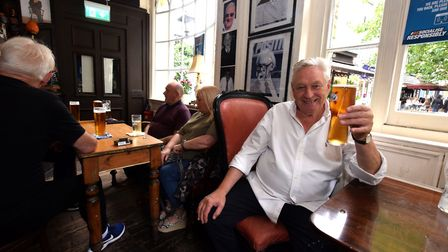 Landlord Jimmy McGrath joins customers for a pint inside King William IV in Hampstead High Street. P