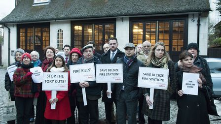 Demonstrators outside Belsize Fire Station protesting against the station closure. Picture: Nigel Su