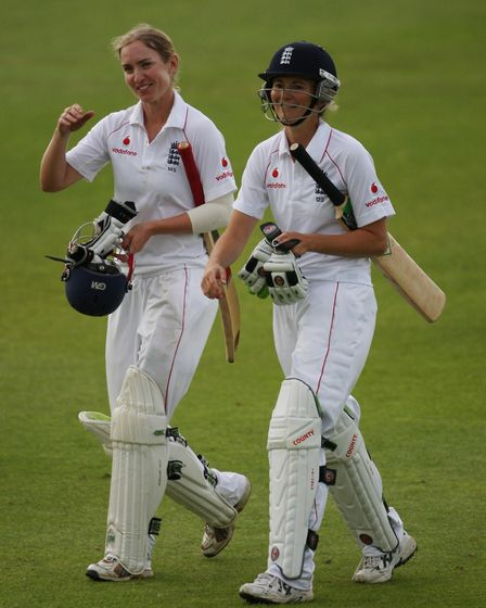 England's Beth Morgan (left) and captain Charlotte Edwards celebrate retaining the Ashes after batti