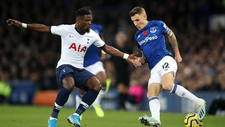 Tottenham Hotspur's Serge Aurier (left) and Everton's Lucas Digne battle for the ball during the Pre