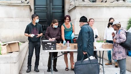 Volunteers hand out free toiletries to rough sleepers. Picture: James TYE